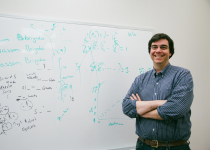 Picture of Dr. Micheal Colaresi standing in front of the white board