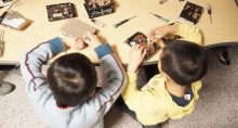Children playing with electronic components